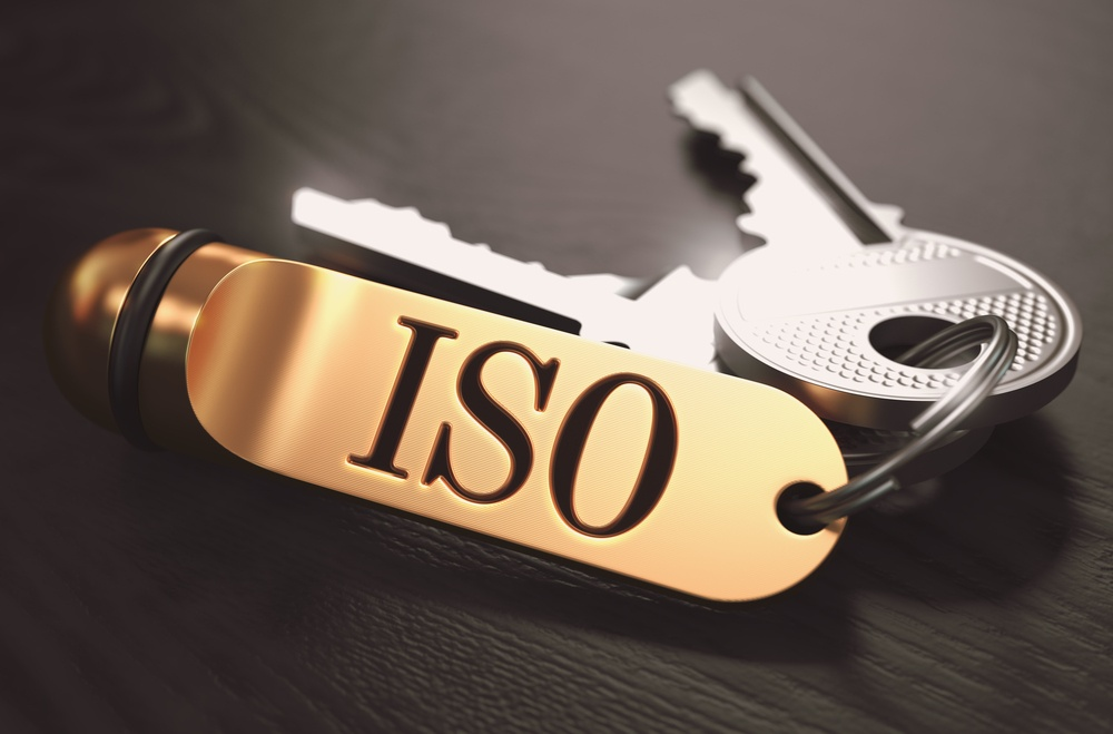 ISO - International Organization for Standardization - Concept. Keys with Golden Keyring on Black Wooden Table. Closeup View, Selective Focus, 3D Render. Toned Image..jpeg