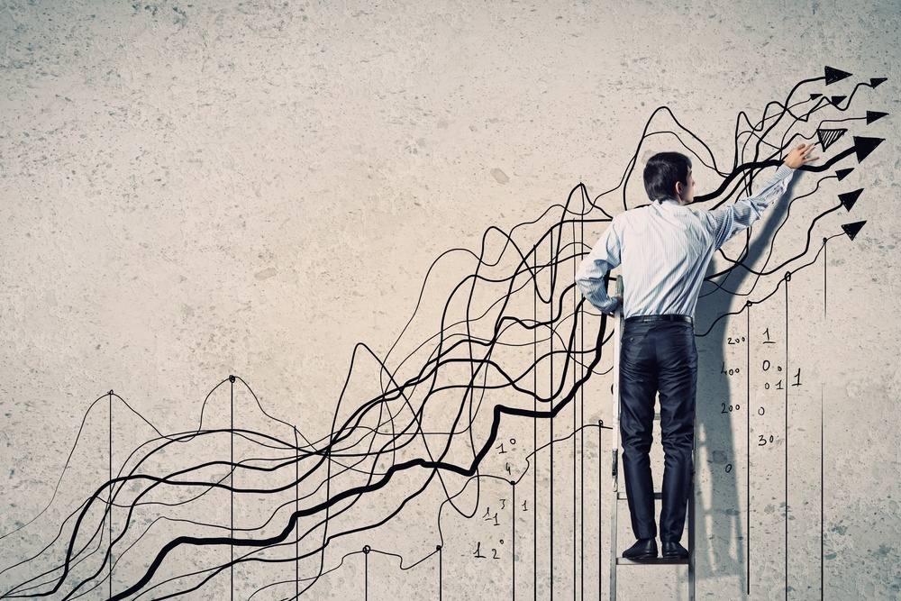 Setup Reduction and ERP Back view image of businessman drawing graphics on wall.jpeg